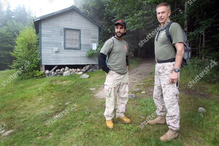 Afghan native Fahim Fazli, left, and retired Marine Michael Moffett are seen at the base of Mount Washington, N.H. before ascending the mountain via the Ammonoosuc Ravine Trail. The two are co-authors of a book about Fazli's life as an Afghan native who fled his country, became a U.S. Citizen, a Hollywood actor who played roles as a Middle eastern terrorist, and returned to Afghanistan to be a translator for U.S. Marines. The two hiked Mount Washington in hopes the Presidential Range would be a stand in for a movie for Asia's Hindu Kush mountains