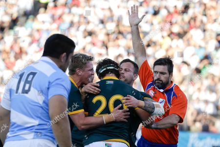 Marcell Coetzee, Jean de Villiers, Morne Steyn, Steve Walsh Referee Steve Walsh of Australia, right, signals a try by South Africa's Marcell Coetzee (20) as Coetzee celebrates with teammates Jean de Villiers, left, and Morne Steyn, second from right, during their Rugby Championship match in Salta, Argentina