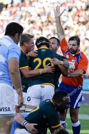 Marcell Coetzee, Jean de Villiers, Morne Steyn,Steve Walsh Referee Steve Walsh of Australia, right, signals a try by South Africa's Marcell Coetzee (20) as Coetzee celebrates with teammates Jean de Villiers, left, and Morne Steyn, second from right, during their Rugby Championship match in Salta, Argentina