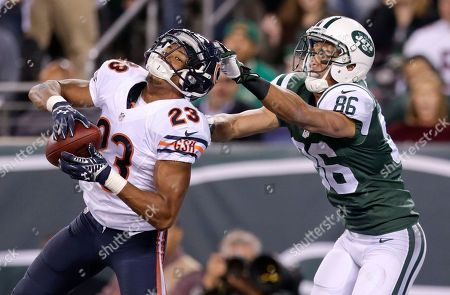 Chicago Bears cornerback Kyle Fuller (23) intercepts a pass in the end zone intended for New York Jets wide receiver David Nelson (86) in the third quarter of an NFL football game, in East Rutherford, N.J