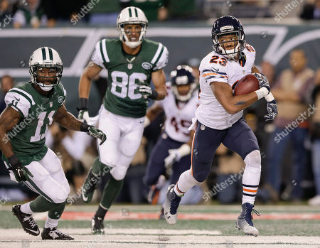 Chicago Bears cornerback Kyle Fuller (23) is pursued by New York Jets wide receiver Jeremy Kerley (11) and wide receiver David Nelson (86) after intercepting a pass in the end zone during the third quarter of an NFL football game, in East Rutherford, N.J