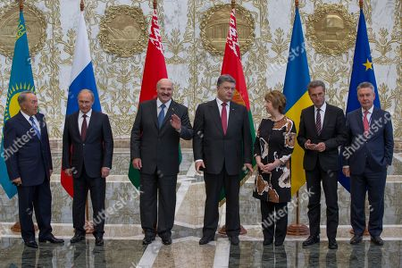 Stock Picture of Vladimir Putin, Catherine Ashton, Petro Poroshenko, Alexander Lukashenko, Nursultan Nazarbayev, Guenther Oettinger, Karel De Gucht From left to right: Kazakh President Nursultan Nazarbayev, Russian President Vladimir Putin, Belarusian President Alexander Lukashenko, Ukrainian President Petro Poroshenko, EU foreign policy chief Catherine Ashton, European Commissioner for Energy Guenther Oettinger, European Commissioner for Trade Karel De Gucht, pose for a photo prior their talks in Minsk, Belarus, . Leaders of Russia, Belarus, two other former Soviet republics as well as top EU officials are meeting in Minsk, Belarus, for a highly anticipated summit to discuss the crisis in Ukraine which has left more than 2,000 dead and displaced over 300,000 people