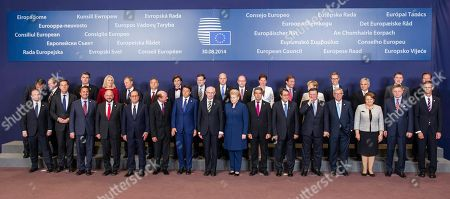 European Union leaders pose during a group photo at an EU summit in Brussels, . EU leaders, in a one day summit, are set to decide who will get the prestigious job as the 28-nation bloc's foreign policy chief for the next five years. They will also discuss the current situation in Ukraine. Front row, left to right, Malta's Prime Minister Joseph Muscat, Dutch Prime Minister Mark Rutte, Luxembourg's Prime Minister Xavier Bettel, European Parliament President Martin Schultz, French President Francois Hollande, Romanian President Traian Basescu, Italian Prime Minister Matteo Renzi, European Council President Herman Van Rompuy, Lithuanian President Dalia Grybauskaite, Bulgarian President Rosen Plevneliev, Cypriot President Nicos Anastasiades, European Commission President Jose Manuel Barroso, European Commission President elect Jean-Claude Juncker, Latvian Prime Minister Laimdota Straujuma, Slovakian Prime Minister Robert Fico and General Secretariat of the Council Uwe Corsepius. Back row left to right, Greek Prime Minister Antonis Samaras, Irish Prime Minister Enda Kenny, Croatian Prime Minister Zoran Milanovic, Danish Prime Minister Helle Thorning-Schmidt, Polish Prime Minister Donald Tusk, Hungarian Prime Minister Viktor Orban, Belgian Prime Minister Elio Di Rupo, Spanish Prime Minister Mariano Rajoy, Swedish Prime Minister Fredrik Reinfeldt, Czech Republic's Prime Minister Bohuslav Sobotka, Slovenian Prime Minister Alenka Bratusek, Portuguese Prime Minister Pedro Passos Coelho, German Chancellor Angela Merkel, Finnish Prime Minister Alexander Stubb, Austrian Chancellor Werner Faymann, Estonian Prime Minister Taavi Roeivas and British Prime Minister David Cameron