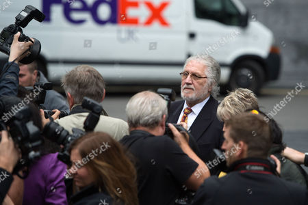 British Disc Jockey Dave Lee Travis, real name David Patrick Griffin, arrives for sentencing at Southwark Crown Court, in London, . The former radio DJ was found guilty of indecently assaulting a woman in 1995
