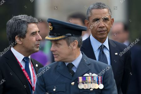 U.S. President Barack Obama, right, Bulgarian President Rosen Plevneliev, left, and British RAF Group Captain David Bentley arrive to watch a flypast at the NATO summit at the Celtic Manor Resort in Newport, Wales on