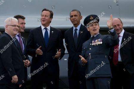 U.S. President Barack Obama, centre right, stands alongside British Prime Minister David Cameron, centre left, NATO Secretary General Anders Fogh Rasmussen, second left, Croatian President Ivo Josipovic, left, Romanian President Traian Basescu, right, and RAF Group Captain David Bentley, second right, during a flypast at the NATO summit at the Celtic Manor Resort in Newport, Wales on