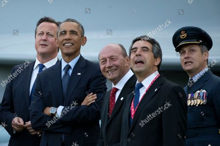 From left, British Prime Minister David Cameron, U.S. President Barack Obama, Romanian President Traian Basescu, Bulgarian President Rosen Plevneliev and British RAF Group Captain David Bentley watch a flypast on the second day of a NATO summit at the Celtic Manor Resort in Newport, Wales on