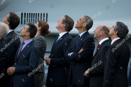 NATO Secretary General Anders Fogh Rasmussen, second left, and NATO leaders, from left, including Dutch Prime Minister Mark Rutte, Slovenian Prime Minister Alenka Bratusek, British Prime Minister David Cameron, U.S. President Barack Obama, Romanian President Traian Basescu and Bulgarian President Rosen Plevneliev watch a flypast at the NATO summit at the Celtic Manor Resort in Newport, Wales on
