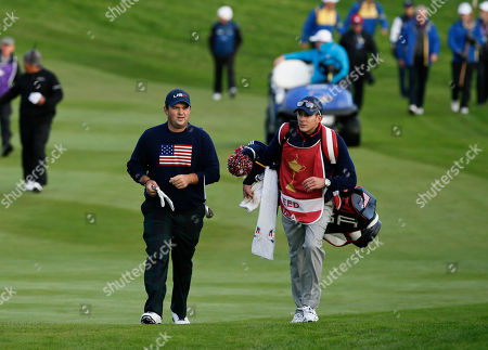 Patrick Reed, Kessler Karain Patrick Reed, left, of the US and his caddie Kessler Karain walk along the 1st fairway during the fourball match on the second day of the Ryder Cup golf tournament, at Gleneagles, Scotland