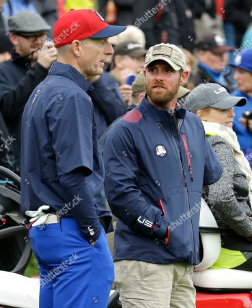 War veteran Noah Galloway, right, talks with Jim Furyk of the US on the 18th green during a practice round ahead of the Ryder Cup golf tournament at Gleneagles, Scotland