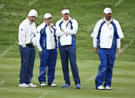 Sam Torrance, Paul McGinley, Ian Poulter, Thomas Bjorn From left, Europe team vice captain Sam Torrance, captain Paul McGinley, Ian Poulter and Thomas Bjorn watch the foursomes match between Europe's Lee Westwood, Europe's Jamie Donaldson, Matt Kuchar of the US Zach Johnson of the US on the 17th hole on the second day of the Ryder Cup golf tournament, at Gleneagles, Scotland