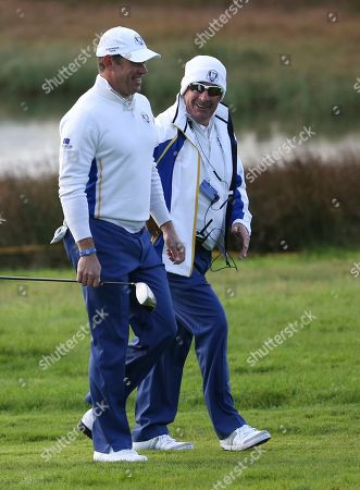 Sam Torrance, Lee Westwood Europe team vice captain Sam Torrance walks along the 3rd fairway with Lee Westwood, left, during the fourball match on the second day of the Ryder Cup golf tournament, at Gleneagles, Scotland