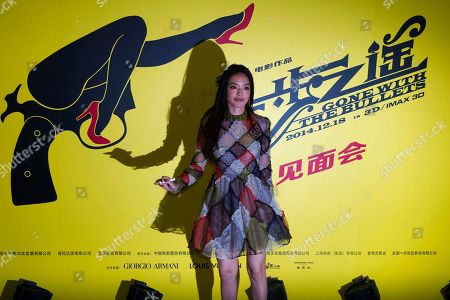"""Lead actress Shu Qi arrives at a press conference for the new 3D movie """"Gone with the Bullets"""" in Beijing, China, . Hoping for maximum publicity, Chinese director Jiang Wen launched his latest movie at an event Monday more than three months before it is due to open in cinemas"""
