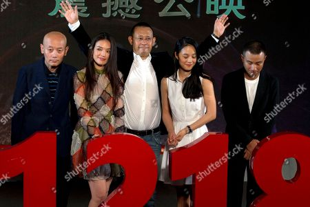 """Chinese director Jiang Wen, center, waves near cast members from right Wen Zhang, Zhou Yun, Shu Qi and Ge You at a press conference for his new 3D movie """"Gone with the Bullets"""" in Beijing, China, . Hoping for maximum publicity, Chinese director Jiang Wen launched his latest movie at an event Monday more than three months before it is due to open in cinemas"""