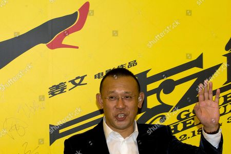 """Chinese director Jiang Wen arrives for a press conference for his new 3D movie """"Gone with the Bullets"""" in Beijing, China, . Hoping for maximum publicity, Chinese director Jiang Wen launched his latest movie at an event Monday more than three months before it is due to open in cinemas"""