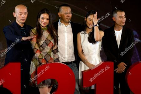 """Jiang Wen Wen Zhang, Zhou Yun, Shu Qi and Ge You Chinese director Jiang Wen, center, poses for photos near cast members from right Wen Zhang, Zhou Yun, Shu Qi and Ge You at a press conference for his new 3D movie """"Gone with the Bullets"""" in Beijing, China, . Hoping for maximum publicity, Chinese director Jiang Wen launched his latest movie at an event Monday more than three months before it is due to open in cinemas"""