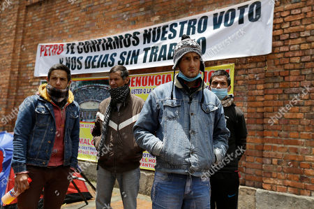 "Colombian bullfighters Omar Rodriguez, left, Alfredo Pena, second left, Diego Torres, second right, and David Rodriguez, right, stand outside La Santa Maria bullring while staging a hunger strike in Bogota, Colombia, . Eight bullfighters have been striking for more than a week in tents outside the city's only bullring after Mayor Gustavo Petro ended bullfighting in the city when he cancelled the bullring's lease in June 2012. He said he wanted public places to be used for activities of ""life, not death"