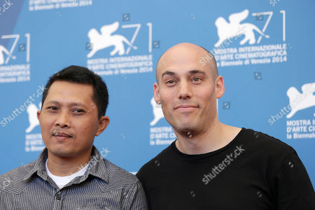 Actor Adi Rukun, left, and director Joshua Oppenheimer pose for photographers at the photo call for the film The Look of Silence the 71st edition of the Venice Film Festival in Venice, Italy