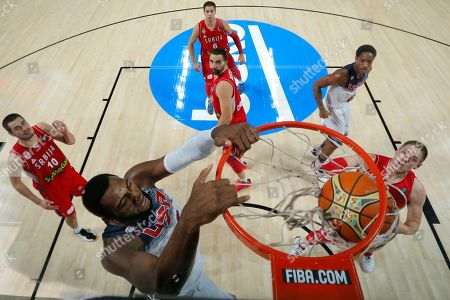 Kyrie Irving EDITORS LIBRARIANS, ARCHIVISTS THIS CORRECTS NAME OF U.S. PLAYER TO ANDRE DRUMMOND -- U.S.Andre Drummond, left, dunks during the final 2014 World Basketball match between the U.S and Serbia at the Palacio de los Deportes stadium in Madrid, Spain