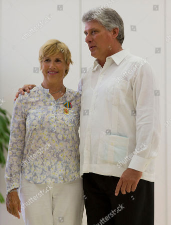 Diana Nyad U.S. endurance swimmer Diana Nyad wears her Order of Sporting Merit medal as she poses for photos with Cuba's Vice President Miguel Diaz-Canel after a ceremony in Havana, Cuba, . Cuba honored Nyad for being the first swimmer to make the crossing between Cuba and Florida without flippers or a shark cage for protection. Nyad made four previous attempts; first in 1978, and three times in 2011 and 2012