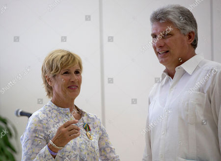 Diana Nyad U.S. endurance swimmer Diana Nyad wears her Order of Sporting Merit medal as she speaks with Cuba's Vice President Miguel Diaz-Canel after a ceremony in Havana, Cuba, . Cuba honored Nyad for being the first swimmer to make the crossing between Cuba and Florida without flippers or a shark cage for protection. Nyad made four previous attempts; first in 1978, and three times in 2011 and 2012