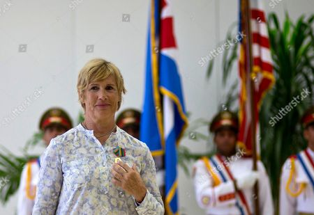 Diana Nyad U.S. endurance swimmer Diana Nyad wears her Order of Sporting Merit medal as she stands in front of the Cuban and U.S. flags during a ceremony in Havana, Cuba, . Cuba honored Nyad for being the first swimmer to make the crossing between Cuba and Florida without flippers or a shark cage for protection. Nyad made four previous attempts; first in 1978, and three times in 2011 and 2012
