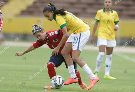 Stock Picture of Daniela Montoya, Andressa Alves Colombia's Daniela Montoya, left, fights for the ball with Brazil's Andressa Alves during a Women's Copa America soccer match in Quito, Ecuador, . The top two teams will qualify directly to the World Cup, and the third placed team will play in a play-off against the fourth placed team of the 2014 CONCACAF Women's Championship
