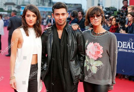 "Actress Sheila Vand, left, and actor Arash Marandi with director Ana Lily Amirpour pose during a presentation for ' A Girl Walks Home Alone at Night"" at the 40th American Film Festival, in Deauville, Normandy, western France"