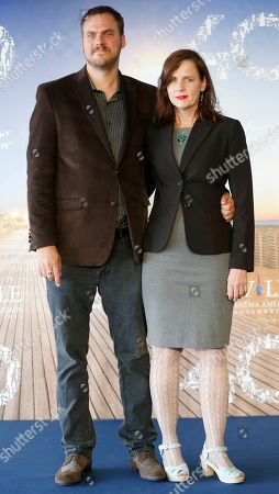 """US. Director Jim Mickle, and producer Linda Moran pose for a picture at the photocall for his film """"Cold in July"""" at the 40th American Film Festival, in Deauville, Normandy, western, France"""