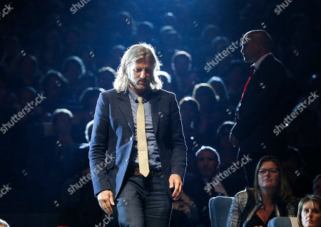 "US director Saar Klein arrives on stage prior to receiving the 40th Anniversary Award for ""Things People Do"" after the closing ceremony of the 40th Deauville American Film Festival of Deauville, Normandy, western, France, Saturday, Sept.13, 2014"