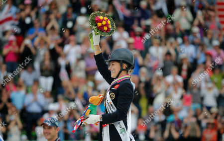 Charlotte Dujardin Gold medalist Charlotte Dujardin of Great Britain, poses on the podium during the medal ceremony during freestyle Grand Prix individual dressage competition at the FEI World Equestrian Games, at Michel d'Ornano stadium in Caen, western France, . Charlotte Dujardin of Great Britain won on Valegro ahead of German Helen Langenhanenberg on Damon Hill and Dutch Adelinde Cornelissen on Jerich Parzival