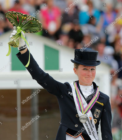 Helen Langenhanenberg Silver medalist Helen Langenhanenberg of Germany, acknowledges applauses during the medal ceremony at the freestyle Grand Prix individual dressage competition at the FEI World Equestrian Games, at Michel d'Ornano stadium in Caen, western France, . Charlotte Dujardin of Great Britain won on Valegro ahead of German Helen Langenhanenberg on Damon Hill and Dutch Adelinde Cornelissen on Jerich Parzival