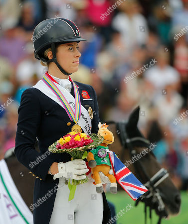 Charlotte Dujardin Gold medalist Charlotte Dujardin of Great Britain, listening to the British National anthem during the medal ceremony during freestyle Grand Prix individual dressage competition at the FEI World Equestrian Games, at Michel d'Ornano stadium in Caen, western France, . Charlotte Dujardin won on Valegro head of German Helen Langenhanenberg on Damon Hill and Dutch Adelinde Cornelissen on Jerich Parzival. Dujardin horse Valegro in the background