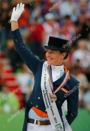 Adelinde Cornelissen Silver medalist Adelinde Cornelissen of the Netherlands, acknowledges applause during the medal ceremony of the freestyle Grand Prix individual dressage competition at the FEI World Equestrian Games, at Michel d'Ornano stadium in Caen, western France, . Charlotte Dujardin of Great Britain won on Valegro ahead of German Helen Langenhanenberg on Damon Hill and Dutch Adelinde Cornelissen on Jerich Parzival