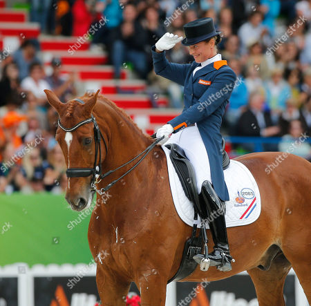Adelinde Cornelissen Adelinde Cornelissen of the Netherlands, riding Jecih Parzival, acknowledges applauses after her presentation during the freestyle Grand Prix individual dressage competition at the FEI World Equestrian Games, at Michel d'Ornano stadium in Caen, western France, . Charlotte Dujardin of Great Britain won on Valegro ahead of German Helen Langenhanenberg on Damon Hill and Dutch Adelinde Cornelissen on Jerich Parzival