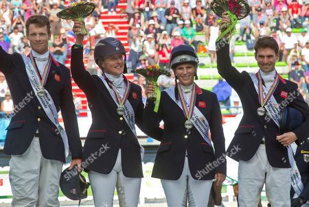 William Fox-Pitt, Kristina Cook, Zara Phillips, Harry Meade British silver medalists from left, William Fox-Pitt, Kristina Cook, Zara Phillips and Harry Meade pose on the podium during the medal ceremony of the Eventing competition at the FEI World Equestrian Games, at the French National Stud, in Caen, western France, . Germany won in the team competition, ahead of Britain and the Netherlands