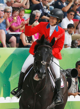 Beezie Madden Beezie Madden of the United States, riding Cortes 'C' acknowledges applause after finishing the 4th round of the individual qualifying show jumping event at the FEI World Equestrian Games in Caen, western France, . Madden of the United States is qualified for the Final 4 on Sunday with Patrice Delaveau of France, Rolf-Goeran Bengstsson of Sweden and Jeroen Dubbeldam of the Netherlands