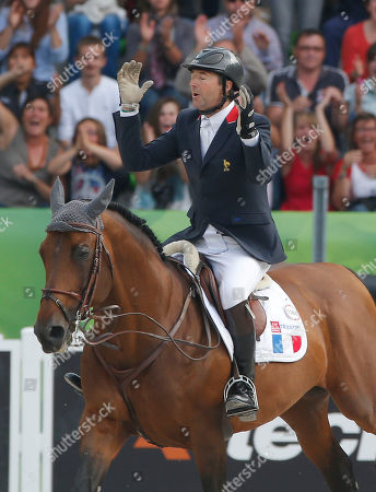 Patrice Delaveau Patrice Delaveau of France, riding Orient Express, reacts after finishing the 4th round of the individual qualifying show jumping event at the FEI World Equestrian Games in Caen, western France, . Patrice Delaveau of France is qualified for the Final 4 on Sunday with Beezie Madden of the United States, Rolf-Goeran Bengstsson of Sweden and Jeroen Dubbeldam of the Netherlands