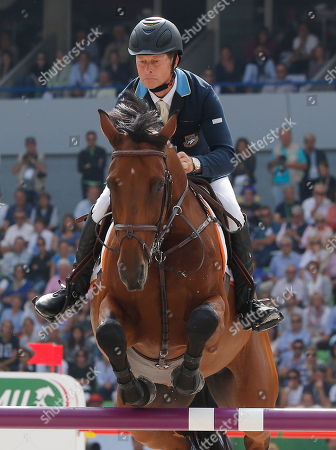 Beezie Madden Sweden's Rolf-Goeran Bengtsson rides Zenith SFN during the Final 4 show jumping event at the FEI World Equestrian Games in Caen, western France, . Dutch rider Jeroen Dubbeldam won the jumping competition at the World Equestrian games with four clear rounds in the final four on Sunday. French rider Patrice Delaveau won silver and American rider Bezzie Madden took the bronze medal. In the final four format, every rider jumps four rounds - one round on their won horses and then one round on each of their rivals' horses