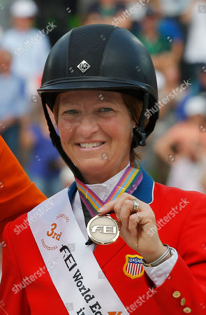 Beezie Madden Bronze medalist Beezie Madden of the United States, poses on the podium during the medal ceremony of the Final 4 show jumping event at the FEI World Equestrian Games in Caen, western France, . Dutch rider Jeroen Dubbeldam won the jumping competition at the World Equestrian games with four clear rounds in the final four on Sunday. French rider Patrice Delaveau won silver and American rider Bezzie Madden took the bronze medal