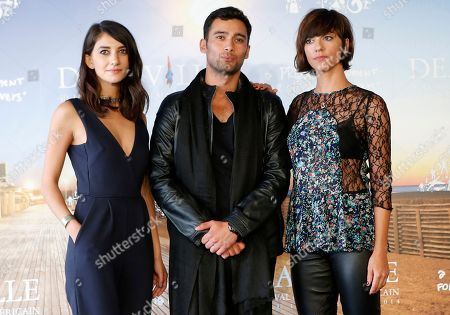 "Actress Sheila Vand, left, and actor Arash Marandi with director Ana Lily Amirpour pose during a photocall for ' A Girl Walks Home Alone at Night"" at the 40th American Film Festival, in Deauville, Normandy, western, France"