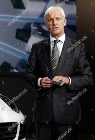 Porsche AG President and CEO Matthias Muller delivers his speech at the Volkswagen Group Gala, as part of the Paris Auto Show, in Paris, . The Paris Auto Show will open its gates to the public from Oct. 4 to Oct. 19