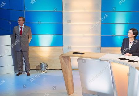 Bodo Ramelow, Christine Lieberknecht Bodo Ramelow, left, top candidate of German party 'Die Linke' (The Left) for the regional parliament elections in Thuringia, waits in a corner besides Christine Lieberknecht, governor and top candidate of the Christian Democratic Union Party, CDU, in a TV talkshow after the state parliament elections in Thuringia in Erfurt, central Germany
