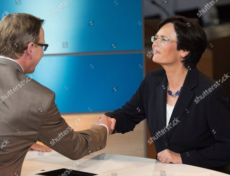 Bodo Ramelow, Christine Lieberknecht Bodo Ramelow, left, top candidate of German party 'Die Linke' (The Left) for the regional parliament elections in Thuringia, shakes hands with Christine Lieberknecht, governor and top candidate of the Christian Democratic Union Party, CDU, after the state parliament elections in Thuringia in Erfurt, central Germany