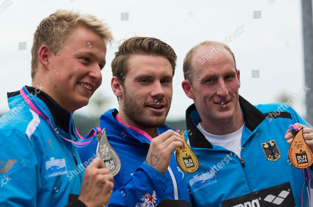 Thomas Lurz, Rob Muffels, Daniel Fogg From left, second placed Rob Muffels of Germany, first placed Daniel Fogg of Great Britain and third placed Thomas Lurz of Germany show their medals during the medal ceremony for the men's 5km open water swim competition at the LEN Swimming European Championships in Berlin, Germany