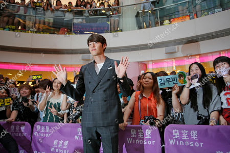 "Kim Woo-bin South Korean actor and model Kim Woo-bin waves to fans during a fan meeting to promote his new film ""Friends 2"" in Hong Kong"