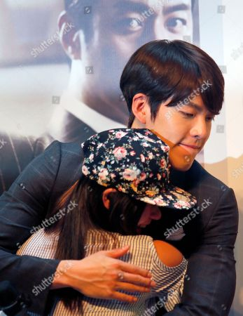 "Kim Woo-bin South Korean actor and model Kim Woo-bin hugs a fan during a fan meeting to promote his new film ""Friends 2"" in Hong Kong"
