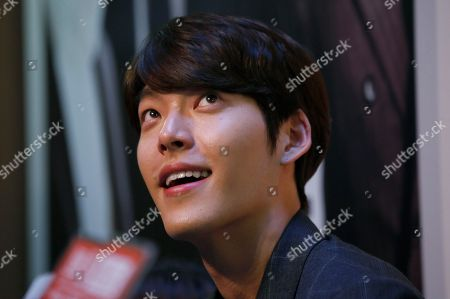 "Kim Woo-bin South Korean actor and model Kim Woo-bin looks at fans during a fan meeting to promote his new film ""Friends 2"" in Hong Kong"