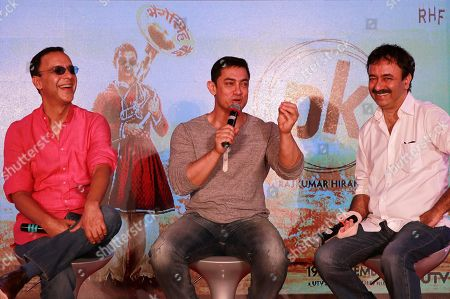 Aamir Khan, Rajkumar Hirani, Vidhu Vinod Chopra Director Rajkumar Hirani right, and producer Vidhu Vinod Chopra, left, enjoy a lighter moment as Bollywood actor Aamir Khan speaks during the unveiling of the second poster of his upcoming film PK in Mumbai, India, .The movie is scheduled for release on December 19
