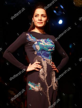 Bollywood actress Celina Jaitly poses for photographs on the sidelines of the Lakme Fashion Week in Mumbai, India